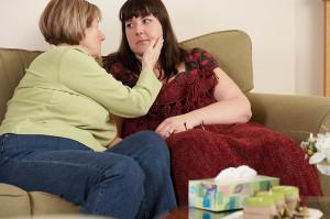 2 women comforting